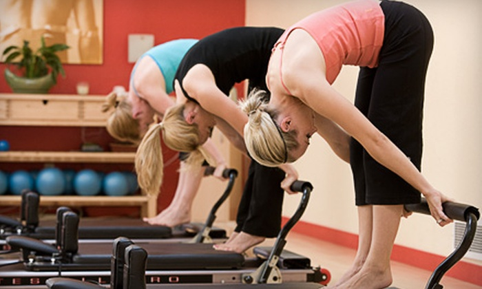 Young Pilates & Fitness - Seattle: $48 for Four Pilates Reformer Classes at Young Pilates & Fitness ($100 Value)