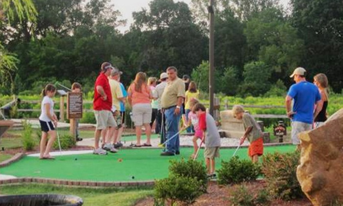 Mac N Bones Golf & Grill - Flowood: $28 for Mini-Golf Outing for Four with 16-Inch Pizza and Soft Drinks at Mac N Bones Golf & Grill in Pearl ($56.08 Value)