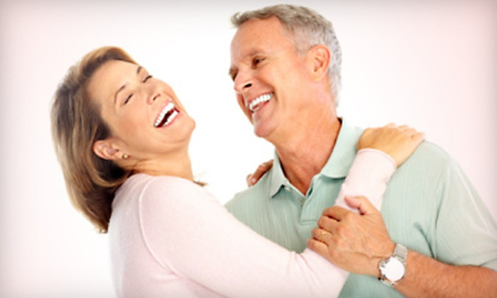 Chicago Smile Center - Multiple Locations: $1,399 for Implant Consultation, X-Rays, Implant, Stock Abutment, and Four-Month Follow-Up at Chicago Smile Center ($3,100 Value)