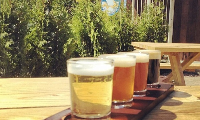 Brutopia Brewery and Kitchen - Cranston: $25  Beer Flight with Four 4 oz. Beers, Appetizer and Growler at Brutopia Brewery and Kitchen ($43 Value)