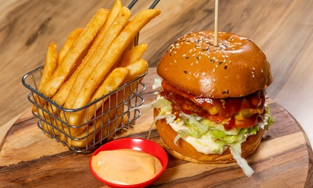 Burger and Drink: 1 $13.50, 2 $27 or 4 People $54 at Pounders Burgers Wings & Fries Up to $87.80 Value