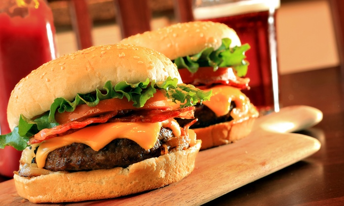 Stacked Pickle - Multiple Locations: $15 for Two Burgers and Two Beers at Stacked Pickle (Up to $25.98 Off)