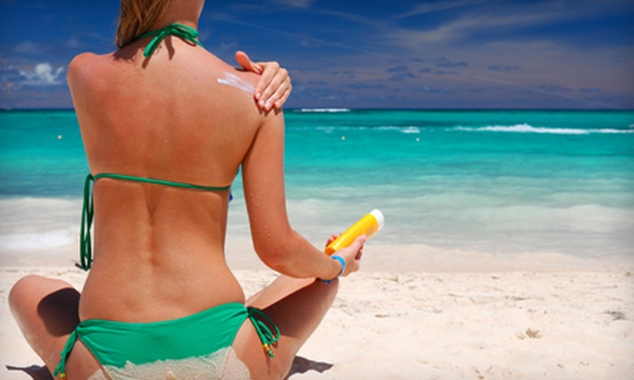 Solar 51 - Multiple Locations: $25 for One Month of Unlimited UV Tanning or Three Mystic Spray Tans at Solar 51 (Up to $89.30 Value)