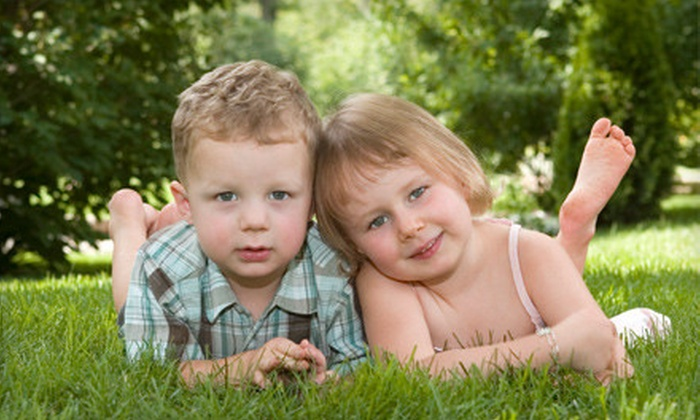 Spectrum Studios - Oakridge: $39 for a One-Hour Photo-Shoot Package with Two Enlargements and Wallet Prints at Spectrum Studios ($165 Value)