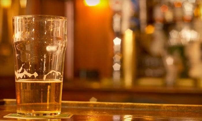 The Dawghouse Pub - Highland: $12 for $25 Worth of Pub Fare & Drinks at The Dawghouse Pub