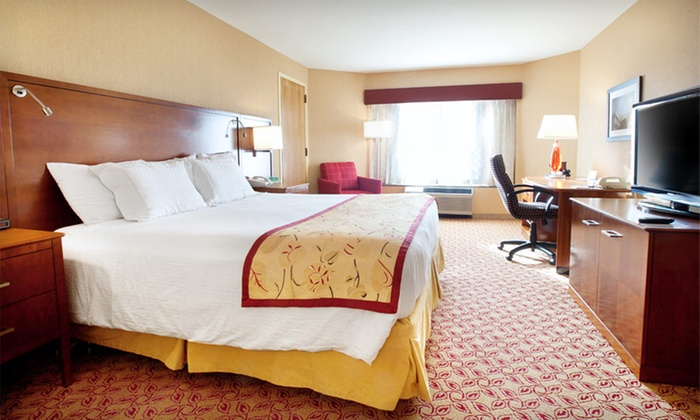 McCamly Plaza Hotel - Morgan Corners,Springfield Place: $99 for a One-Night Stay for Up to Four with Dining Credit at McCamly Plaza Hotel in Michigan (Up to $174 Value)