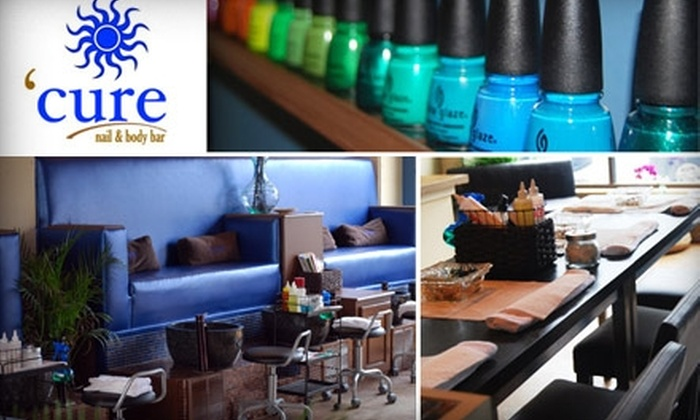 Cure Nail and Body Bar - Multiple Locations: $35 for Luxurious Mani-Pedi at Cure Nail and Body Bar