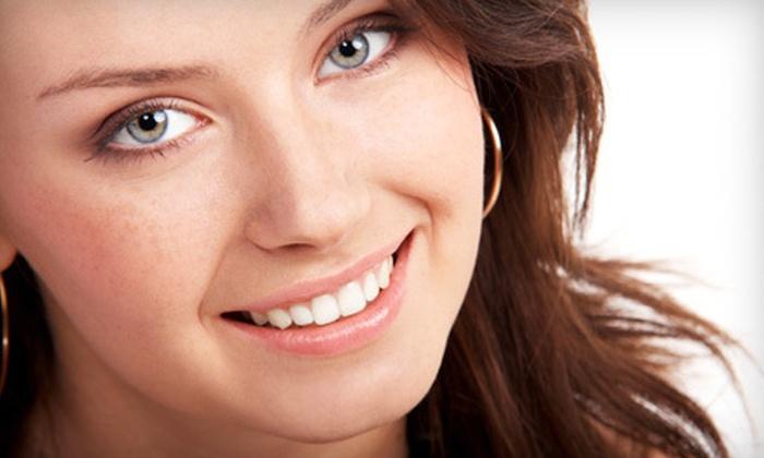 Genesis Dental - Multiple Locations: Dental Exam, Cleaning, and X-rays, In-Office Teeth Whitening, or Two Custom Veneers at Genesis Dental (Up to 85% Off)