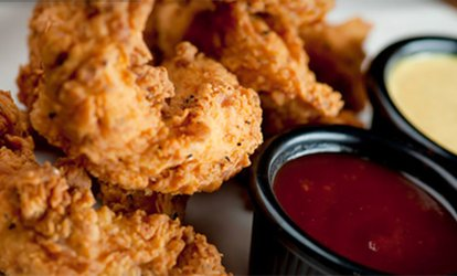 image for Pub-Style Food and Drinks at Tanner's <strong>Bar</strong> And Grill (30% Off)