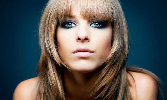 P.H.D. Salon & Spa - Greynolds Highlands: Haircut with Conditioning Treatment, Single-Process Color, or Partial Highlights at P.H.D. Salon & Spa (Up to 69% Off)