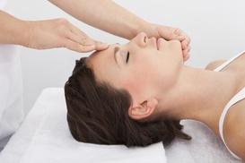 Phoenix Tattoo and Wellness Center: $36 for a Reiki Healing Session ($65 Value) — Phoenix Tattoo and Wellness Center