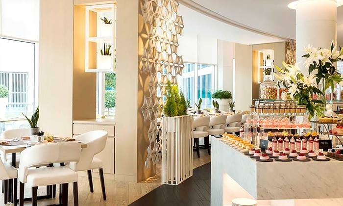 Cafe Palmier at Le Royal Meridien Abu Dhabi - Le Royal Meridien Hotel Abu Dhabi: Friday Brunch and Pool Access for a Child or Adult at Cafe Palmier at Le Royal Meridien Abu Dhabi (Up to 74% Off)