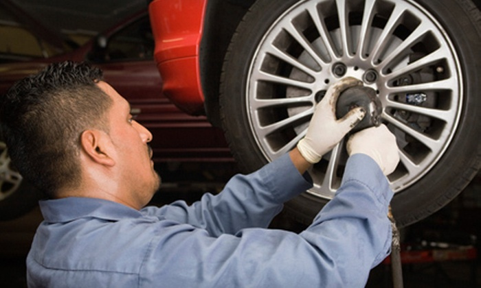 Fletcher's Tire and Auto Service - Multiple Locations: Three or Five Oil Changes or New Disc-Brake Pads at Fletcher's Tire and Auto Service (Up to 79% Off)
