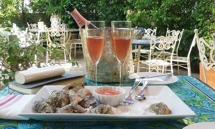 Oyster Leaf Coastal Cuisine - Bayshore: $26 for a Dozen Raw Oysters with Two Glasses of Champagne at Oyster Leaf Coastal Cuisine ($48 Value)