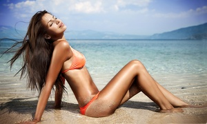 GLOW tanning salon: One Month of UV Tanning, or One or Three Spray Tans Sessions at GLOW tanning salon (Up to 68% Off)