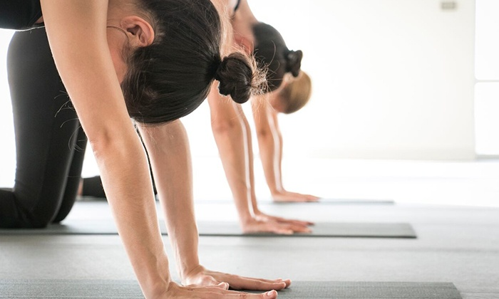 Yoga Six - Multiple Locations: One Month of Unlimited Classes with Optional Childcare at Yoga Six (Up to 77% Off).