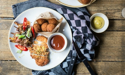 Scheveningen: halve kip met bijgerecht naar keuze incl. dessert bij Alan & Pim's vanaf 2 personen