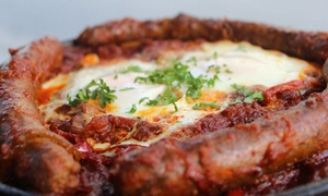 Shakshouka Maraguez, Beef Kebabs, Hummus, and North African Dishes for Two or Four at Salchicha (55% Off)