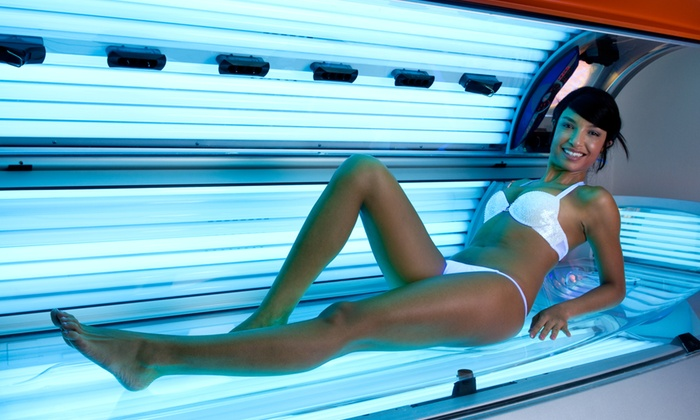 Glo Tan and Boutique - Clinton: One or Two Months of Unlimited UV Tanning or One or Three Spray Tans at Glo Tan and Boutique (Up to 60% Off)