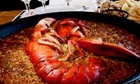 Menú para 2 o 4 con surtido de entrantes, paella de marisco o bogavante y postre desde 24 € en Boo
