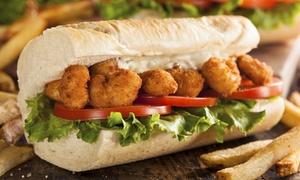 Blazin Cajun: $13 for Po' Boys and Fries for Two at Blazin Cajun ($19.98 Value)