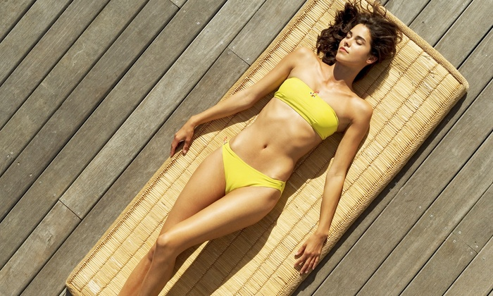Sun Glo Tanning Studio - Hamiliton Place/East Brainerd: All-Access UV Tanning and Versa Sunless Tanning at Sun Glo Tanning (Up to 74% Off). Three Options Available.