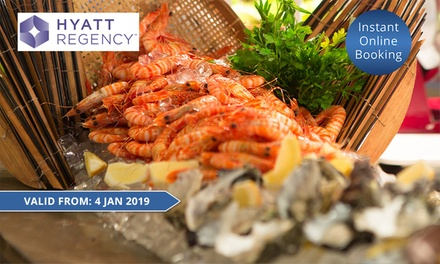 Five-Star Buffet Dinner with Bottle of Wine for Two ($109) or Four People ($218) at Cafe at the Hyatt (Up to $355.80)