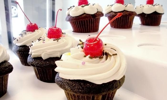 Confetti Cupcakes - Issaquah: $27 for Two Dozen Mini Cupcakes from Confetti Cupcakes ($48 Value)