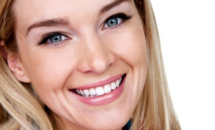 Dental Exam, Basic Cleaning, and X-rays or a Teeth-Whitening Treatment at Crescent City Dentistry (78% Off)