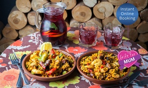 Toro Bravo: Paella With Sangria for Two ($39), Four ($75) or Eight ($149) People at Toro Bravo (Up to $279.2 Value)