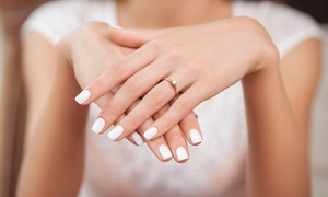 Mlle V: Shellac Manicure or Classic Pedicure with Optional Scrub and Massage at Mlle V (Up to 54% Off)