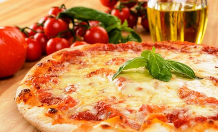 Menu pizza a scelta cotta in forno a legna con birra o vino per 2 o 4 persone da Maniero (sconto fino a 57%)