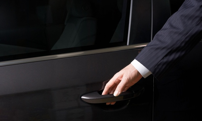 Lilley's Limousine - Portland, ME: Trip to Portland International Jetport in Luxury Sedan or SUVfor Three or Six from Lilley's Limousine (Half Off)