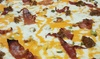 Joes Family Pizzeria - Joes Family Pizzeria: Pizzas, Poutines, Appetizers, and Soft Drinks at Joes Family Pizzeria (Up to 36% Off). Two Options Available.