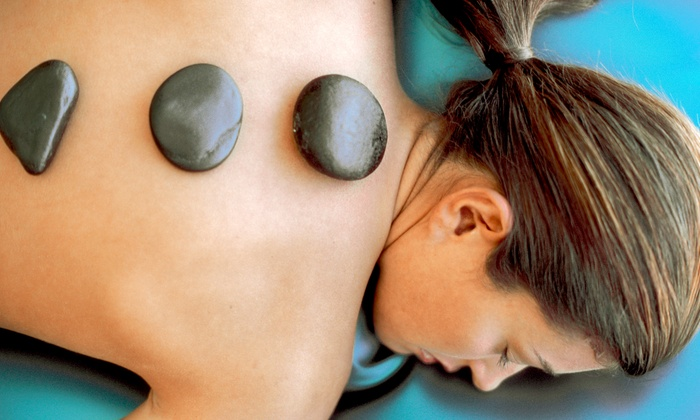 Leesa at Tenacious Tan + Spa - Port St. John: One or Three Aroma-Infused Hot-Stone Massages from Leesa at Tenacious Tan + Spa (Up to 55% Off)