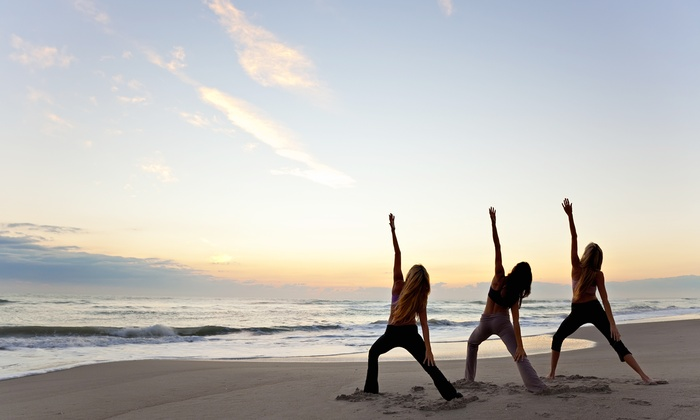 Encompass Yoga - Montrose Beach: 10 Classes, 20 Classes, or a Season Pass for Beach Yoga from Encompass Yoga (Up to 75% Off)