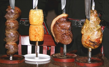 Rodizio Dinner for Two with Bottle of House Wine or Two Desserts at Cowboy Brazilian Steakhouse (Up to 26% Off)