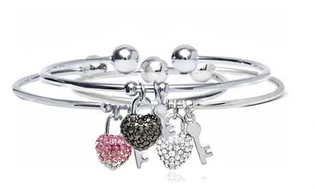 Bracciale modello bangle Love&Key con charms e cristalli di Swarovski® disponibile in...