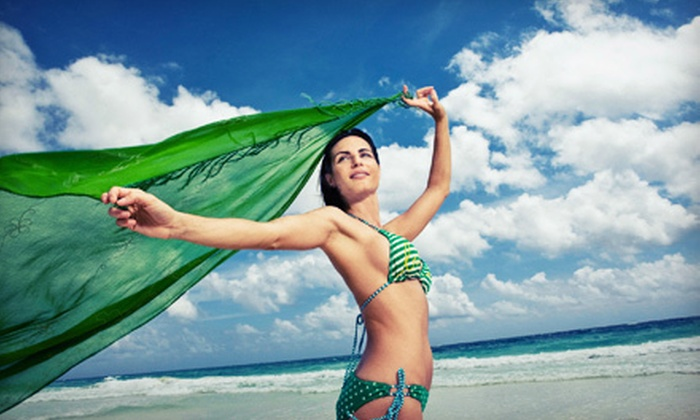 Total Tan - Multiple Locations: One, Three, or Five Infrared Weight-Loss Body Wraps at Total Tan (Up to 78% Off)