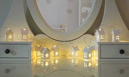 Guirnalda de 10 luces LED decorada con casas de madera por 13 €