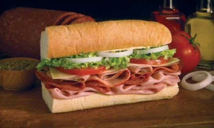 Blimpie - Woodstock: $7 for $15 Worth of Paninis, Wraps, Subs, and Drinks at Blimpie