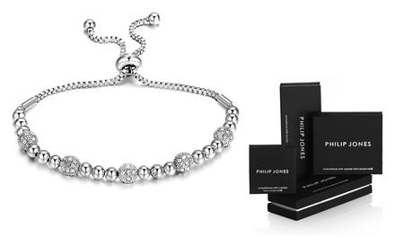 Pulsera amistad bañada en oro blanco con cristales de Swarovski® por 9,99 € (85% de descuento)