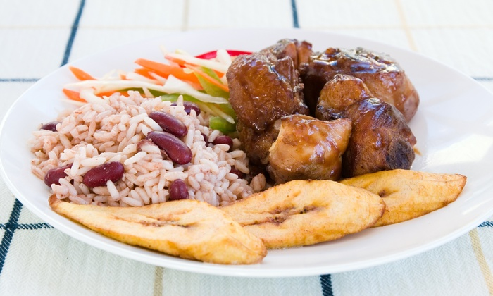 Golden Krust Caribbean Bakery and Grill - Multiple Locations: $12 for Two Small Reggaefest Chicken Combo Meals at Golden Krust Caribbean Bakery and Grill (Up to $25 Value)