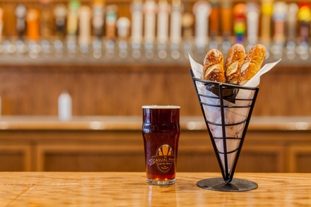 2 Draft Beer Pints with Pretzel & Cheese Appetizer or Chicken Wings at The Casual Pint - Smyrna (Up to 33% Off)
