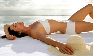 Darque Tan - Colorado: Month of Red-Light Therapy, Two Spray Tans, Three UV Tans, or All Three at Darque Tan (Up to 68% Off)