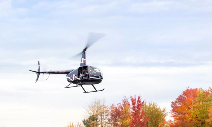 Wings Air Helicopters - Million Air: Piloting Experience for 1 with a Guest or Helicopter Tour for 2 from Wings Air Helicopters (Up to 48% Off)