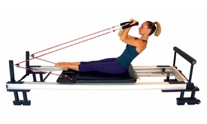 IM=X Pilates: Four or Eight Group Pilates Sessions and One Private Session at IM=X Pilates (Up to 59%Off)