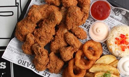 8 o 16 piezas de pollo con patatas fritas, aros de cebolla, ensalada y 2 o 4 bebidas desde 9,95 € en Chicken Guay