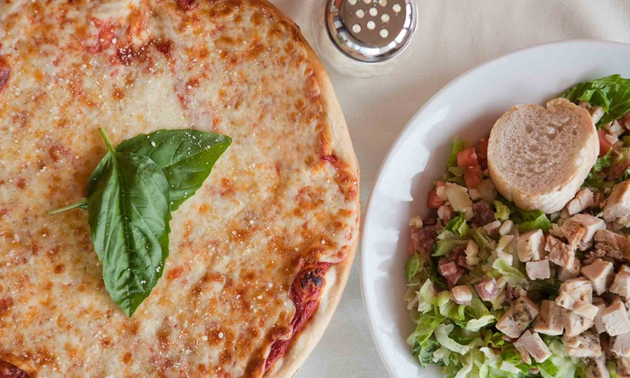 La Famiglia Pizzeria - Ocala: One or Two Groupons, Each Good for $16 Worth of Pizza, Wings, and Sandwiches at La Famiglia Pizzeria (50% Off)