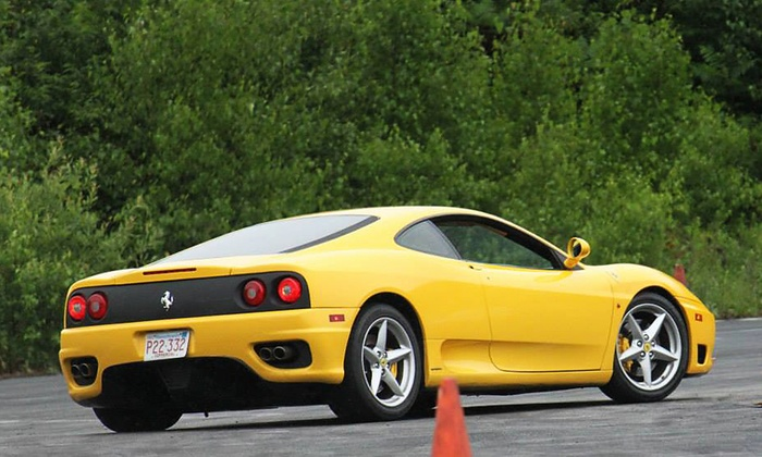 The MotorSport Lab - Dakota County Technical College: 3 or 6 Laps in a Lamborghini or Ferrari with Optional Video from The Motorsport Lab on July 4–6 (Up to 82% Off)